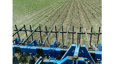 large trailing arm on cultivator