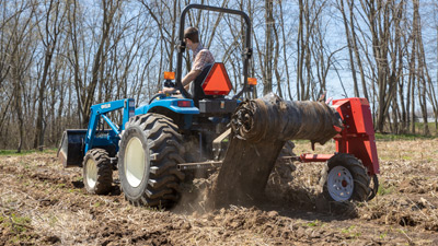 Tilmor Plastic Winder on Compact Tractor