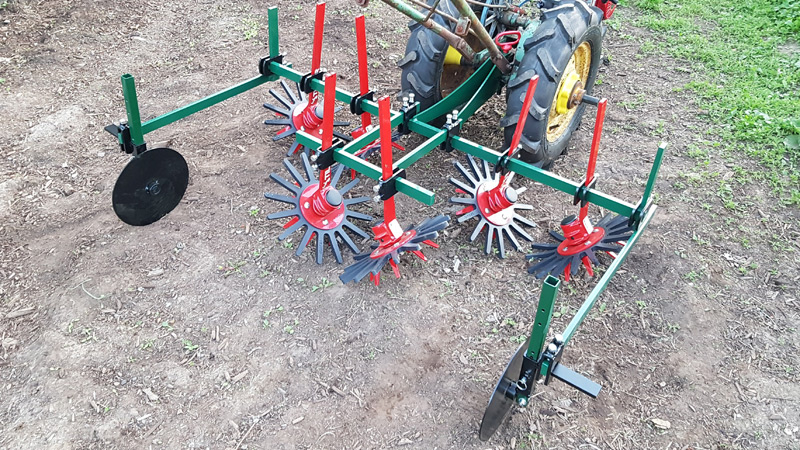 3 Row Finger Weeder on Walk Behind Tractor